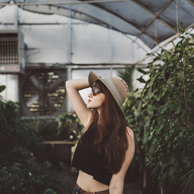Girl in a greenhouse