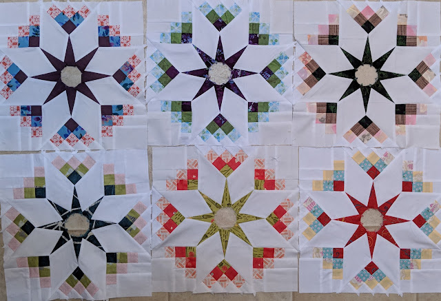 Six blocks arranged on the design wall without their center circles.