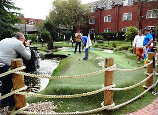 Peter Jones in action in front of the cameras during the American Golf National Adventure Golf grand final at The Belfry