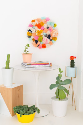http://sugarandcloth.com/2015/03/diy-pom-pom-wall-hang/
