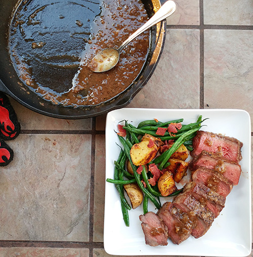 Reverse pan seared NY Strip Steak with roasted garlic and bourbon sauce recipe