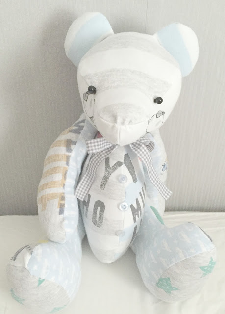bear made from old baby clothing