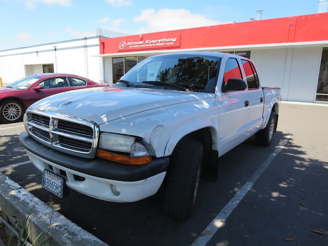 Accident damage on Dodge Dakota before auto body repairs.