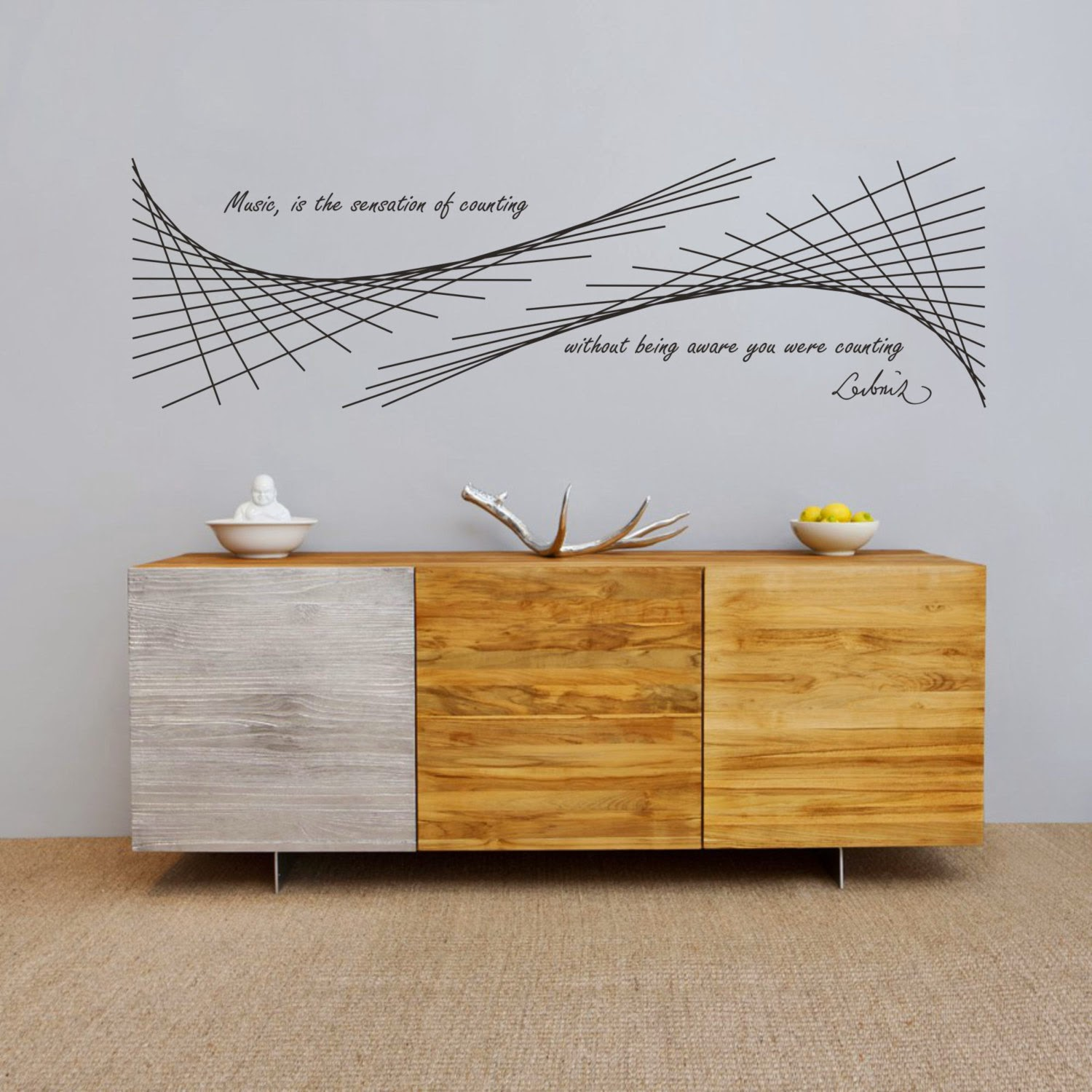 In this science wall decal leibnizs famous quote music is the sensation of counting without being aware you were counting accompanies a geometric art