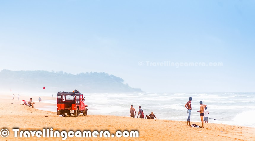 While in Goa, we had not planned to visit Miramar which is in Southern part of Goa. Supposedly this beach is one of the most visited beaches of Goa, which we realized after reaching the beach. Basically we found this beach on our way when we were crossing Panjim City to reach Dona Paula and thought of stopping here. This Photo Journey shares some of the photographs from Miramar Beach in Goa, with some information about the place.Second day of our trip was planned to explore Panjim and surrounding areas. We started early in the morning and hit Panjim very early. We had Dona Paula in our mind as first stop of the day but we when we passing by the panjim City, we noticed a beautiful beach on our right and there was enough parking space as well :). So thought of stopping here and see. To our suprise, there were lot of folks on the beach. When I say 'lot of', it was not crowdy. It's just that we had very less expectations from the beach and we were not even aware which beach is this.While went close to the beach, we asked a coconut vendor about the name and he introduced us to Miramar Beach in Goa. There were lot of families on the beach and it felt great to see cheerful faces on the beach and kids running around. All that touched us and we got a very good impression of Miramar beach.We liked Miramar so much that we planned  to Visit Miramar again in the evening and most of the photographs here are shot in the evening. Above photograph shows a security van which keeps a closer look at all the tourists on the beach and warn them through a loudspeaker if anyone is going deep inside the sea or tries to enter the prohibited area. These vans were there on almost every beach. Miramar Beach is essentially located at the confluence of the River Mandovi and the Arabian Sea. It is relatively a smaller beach and Goa Tourism organize some events on this beach during different occasions in an year, but not as popular events as hosted by Candolim in North Goa.It seems that various edu