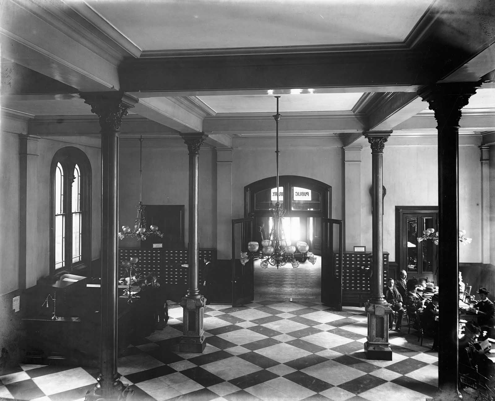 A glimpse of the Main Hall can be seen through vestibule.