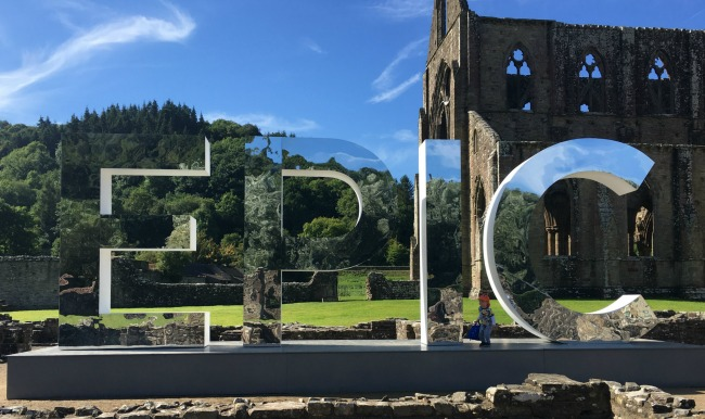 Finding-Our-EPIC-sign-in-front-of-Tintern-Abbey