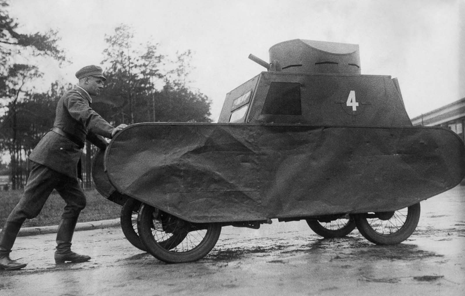 A German soldier pushes a dummy tank. 1931.