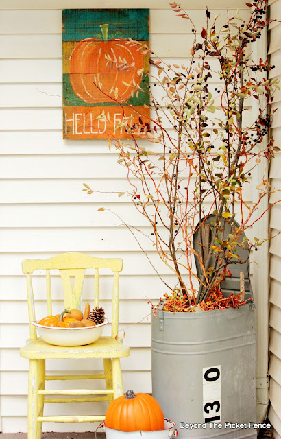 use fall branches and garage sale finds to decorate for fall