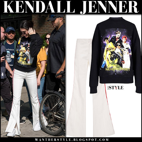 Kendall Jenner in black printed sweatshirt and white wide leg pants new york fashion week 2017 september