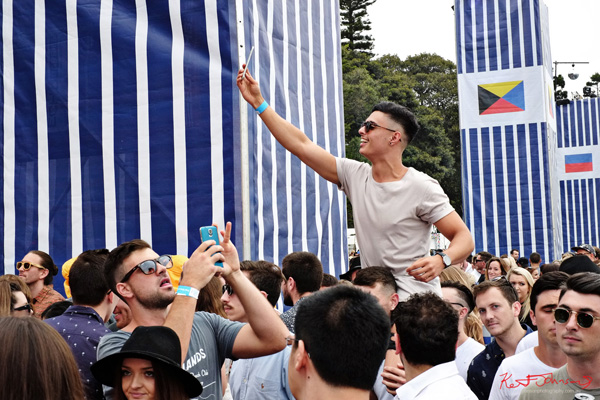 Riding shoulders above the crowd, and a selfie too. Harbour Life Music Festival Sydney 2016. Photographed by Kent Johnson for Street Fashion Sydney.