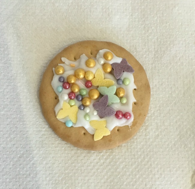 Iced biscuit with butterflies and coloured balls