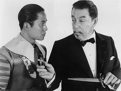 Keye Luke as Number One Son Lee Chan in the Charlie Chan films with Warner Oland