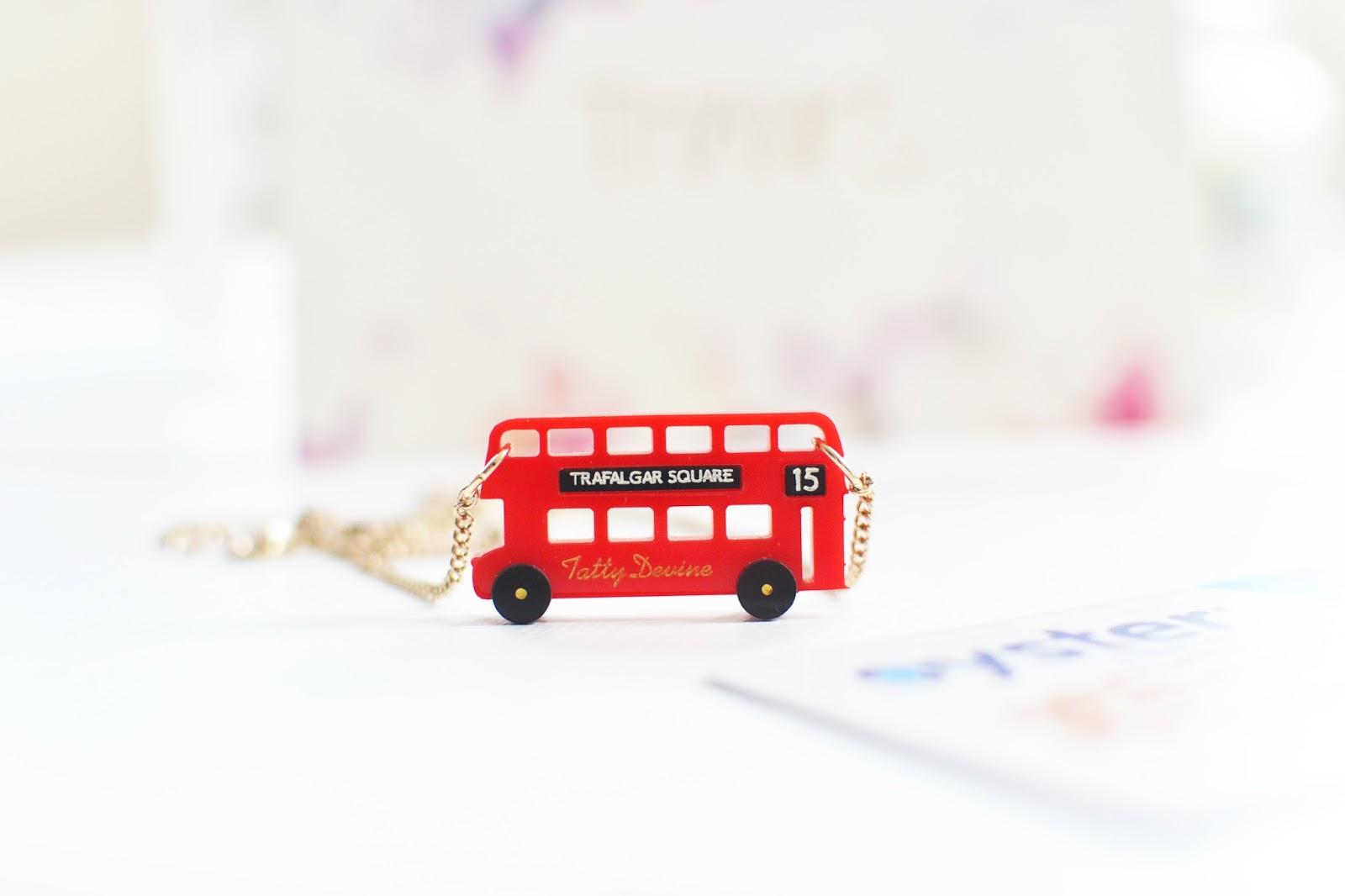 red bus necklace from tatty devine