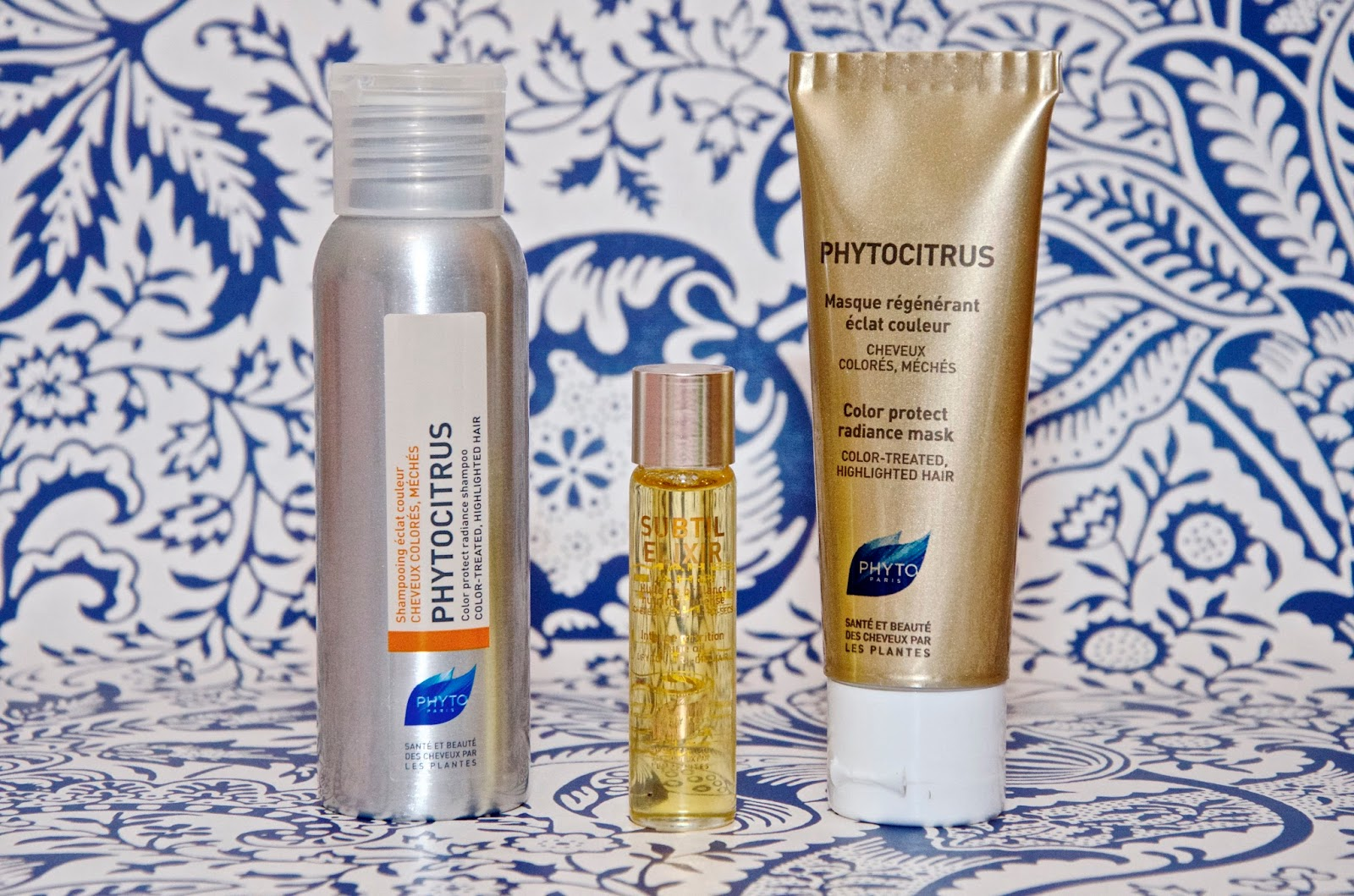 Phyto Shampoo, Phyto hair oil and Phyto hair mask on blue & white background