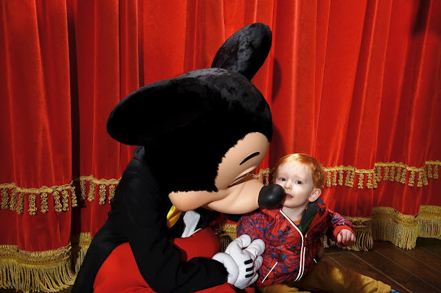 Toddler kissing Mickey