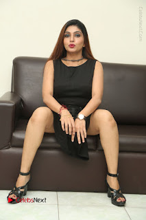 Tollywood Upcoming Actress Pooja Roshan Stills in Black Short Dress at Plus 1 Movie Trailer Launch  0282.JPG