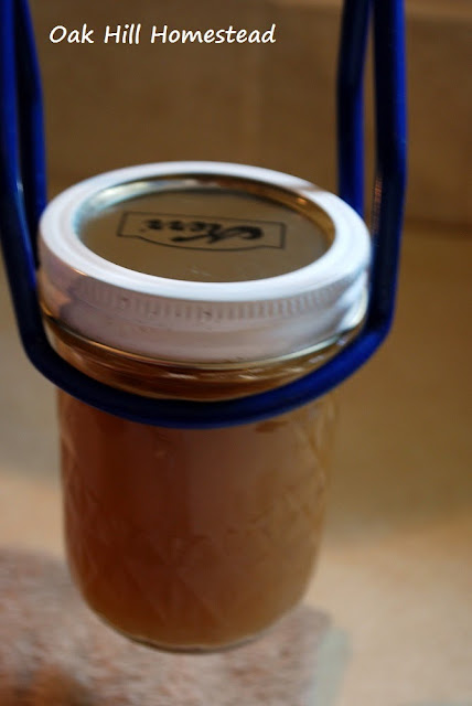 Use a jar lifter to put the jars in the canner.