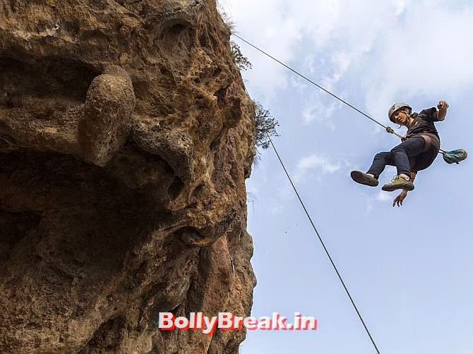 Rock climber Nazia Parveen descends during training in Islamabad February 15, 2014. Parveen is originally from a Federally Administered Tribal Area. , You will love these Pakistani Bold Women of 2014