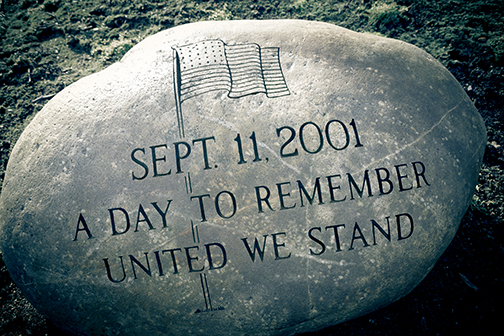 large bolder etched with American flag and text: Sept. 11, 2001 A Day to Remember.  United We Stand.