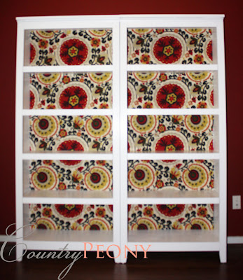 fabric paneled bookcase