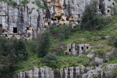 View of Necropolis of Pantalica. Multiple tombs above the Torrente Calcinara.
