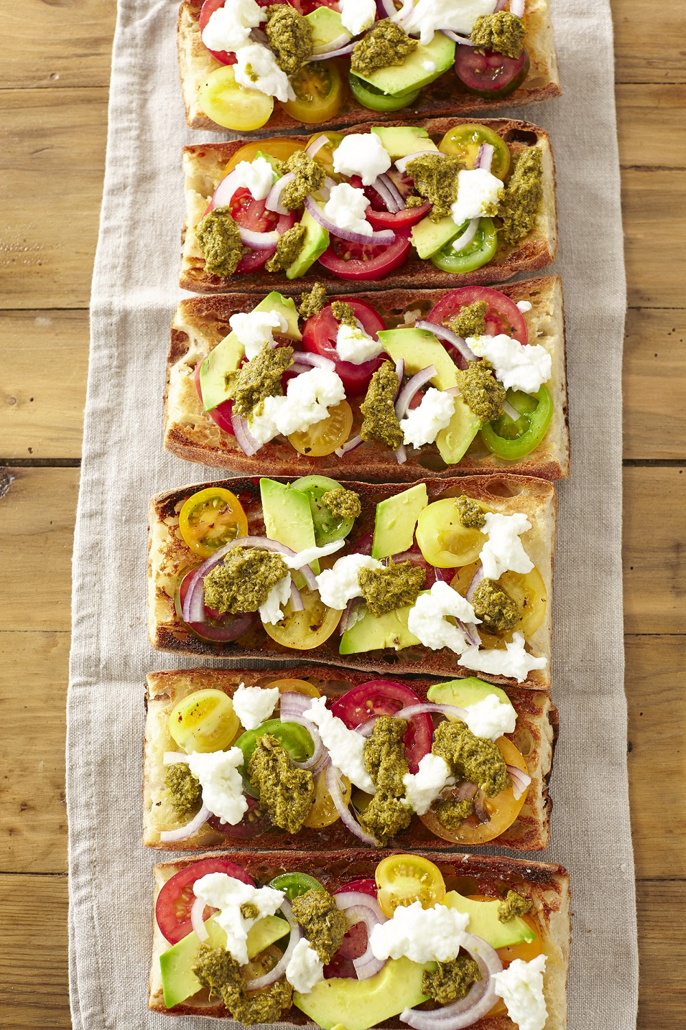 Speciality Tomatoes on Hot Garlic Bread with Pesto