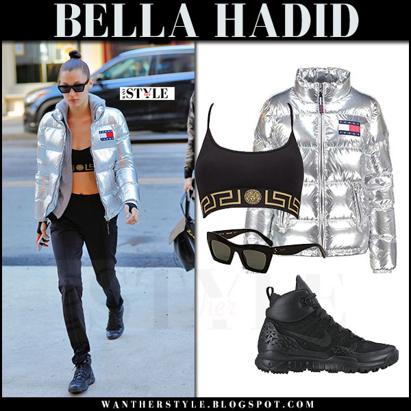 Bella Hadid in silver metallic puffer jacket tommy hilfiger, black versace sports bra, black sweatpants and black sneakers nike lupinek what she wore models off duty style
