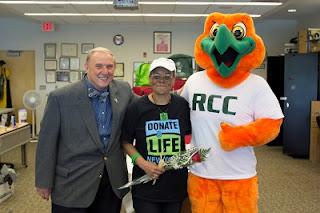 Dr. Wood, Roxanne Watson, and RCC mascot Rocky