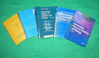 A photograph of all five editions of Intermediate Physics for Medicine and Biology.