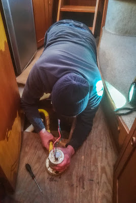 Photo of Phil removing the broken bilge pump