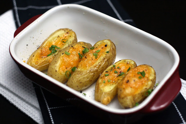 Stuffed Fingerling Potatoes sitting in a red dish. Recipe by BeyondUmami