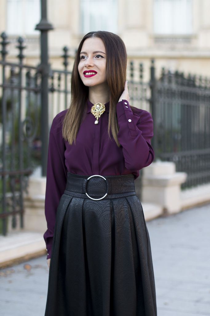 burgundy blouse and gold brooch