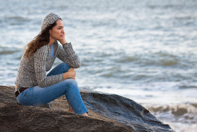 Woman thinking by the ocean