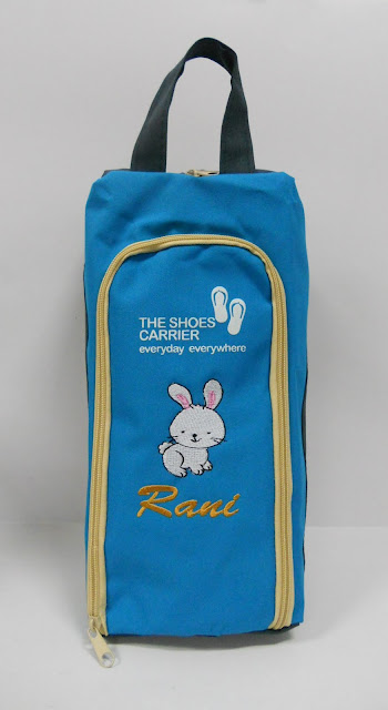 Blue shoebag with name printed on it