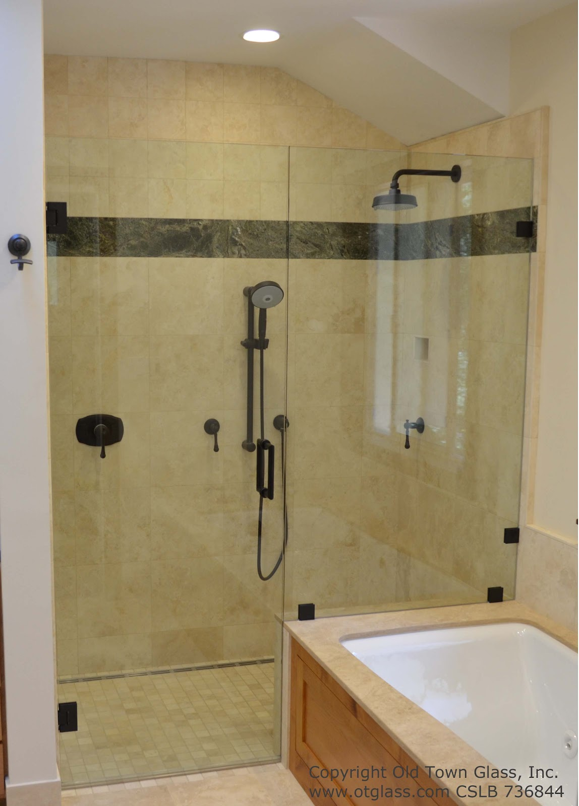 Bath Remodel With An Amazing Glass Shower Enclosure In