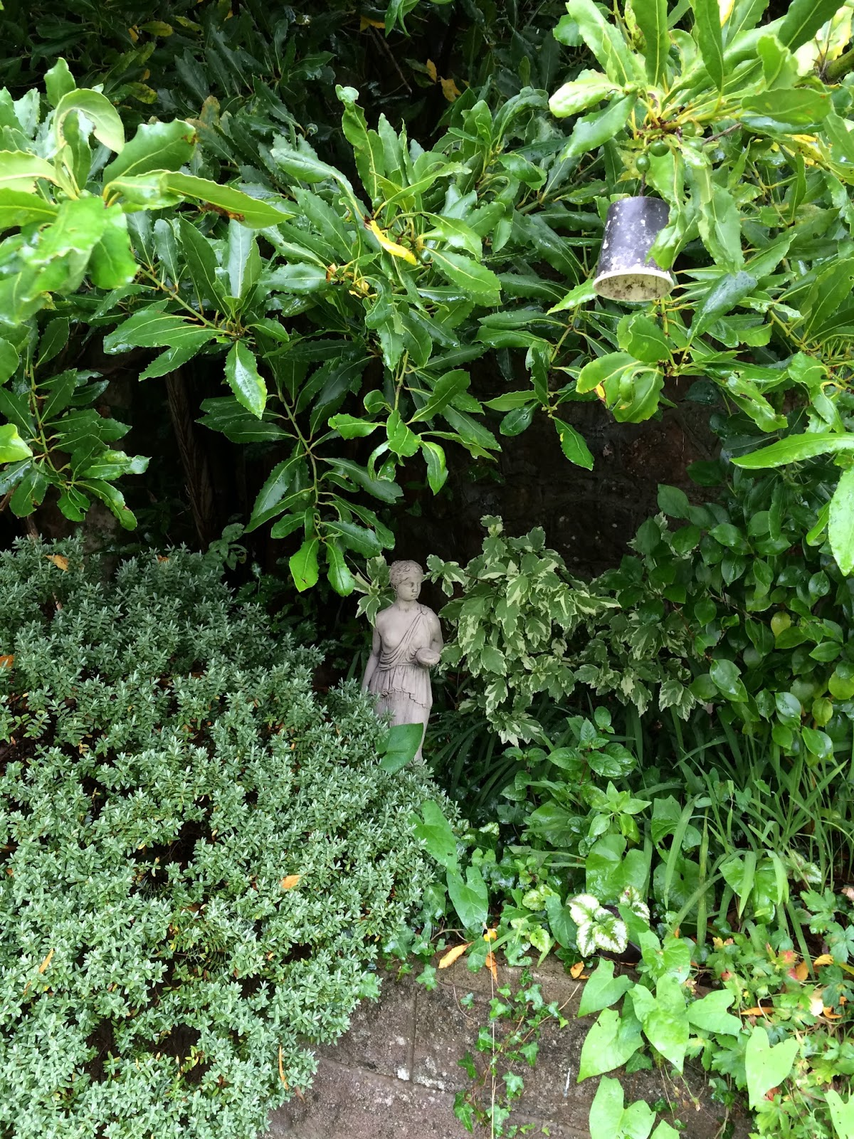 garden clean up - a statue of a grecian lady