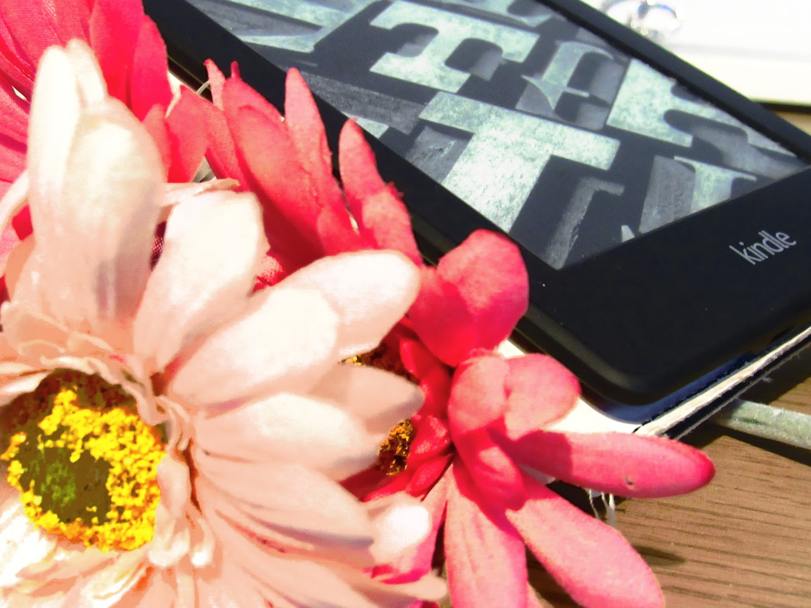 Kindle and pink flower display