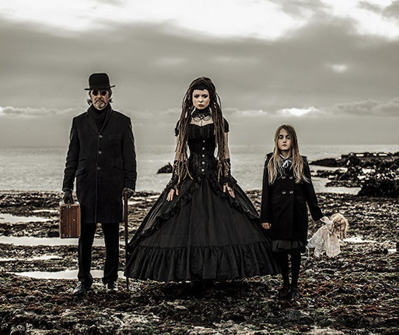 Gothic Victorian family (couple with child) at the beach in gorgeous black goth gown
