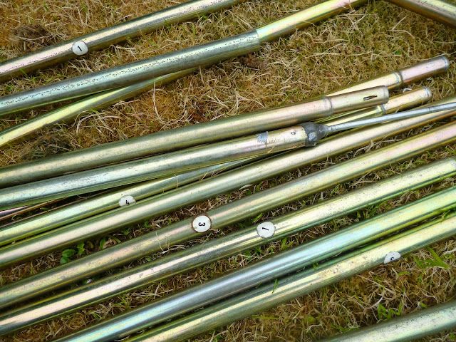 tent poles on the grass