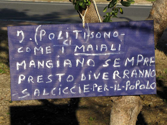 Politicians are like pig: they are always eating, but soon they will be sausages for the people, placard, Livorno