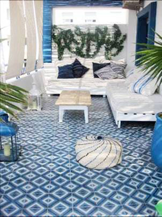 adorned abode archive  Practical and Pretty  Moroccan Floor Tiles I like how they layered a moroccan rug over the tiles  Even more visual  appeal and softens it up