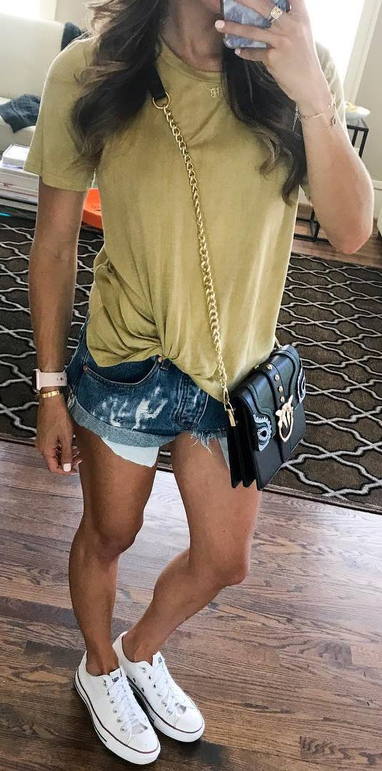 cute street style outfit: bag + t-shirt + shorts