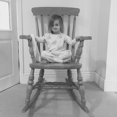 Phoebe (almost 4) sitting in the rocking chair