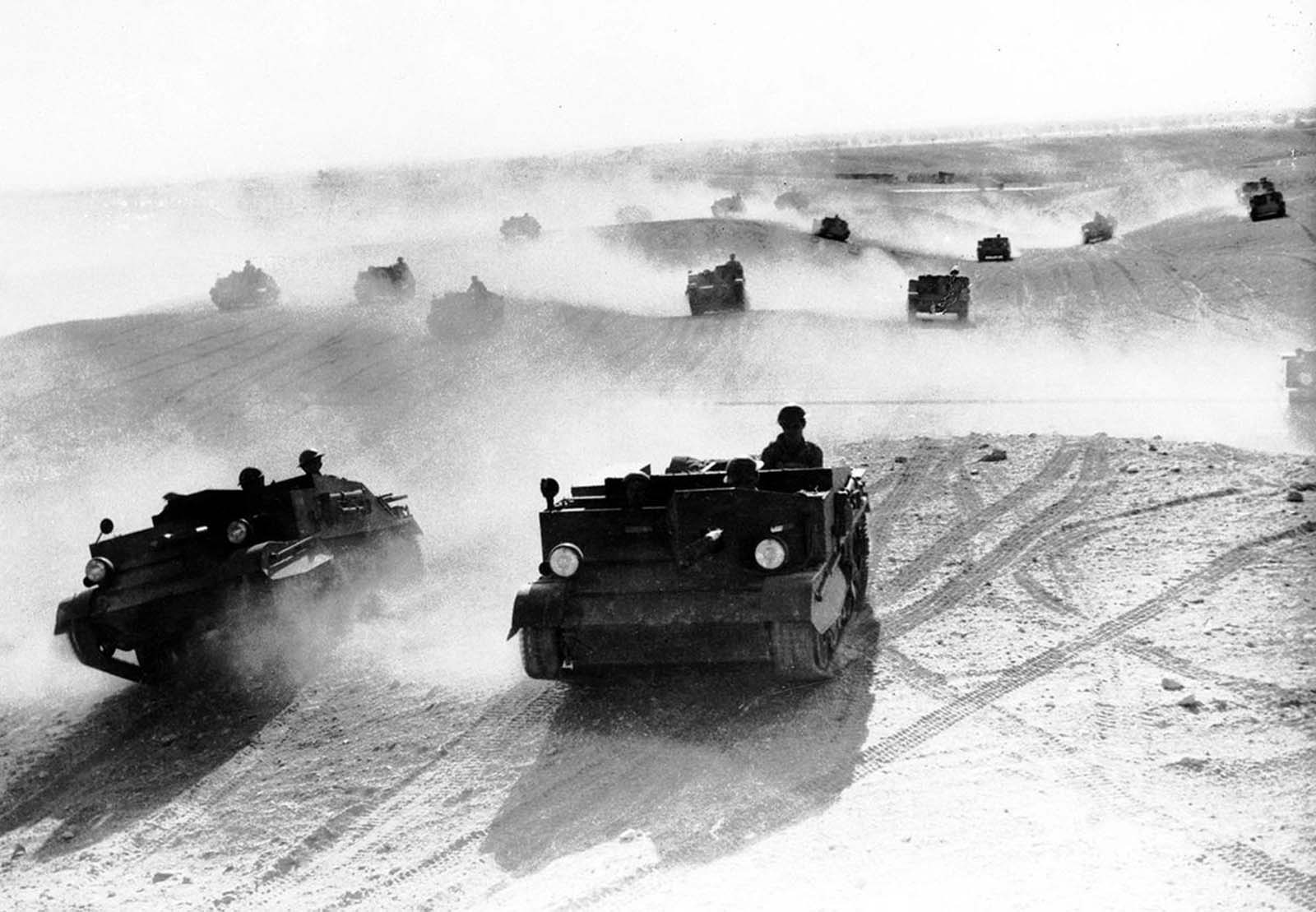 A squadron of Bren gun carriers, manned by the Australian Light Cavalry, rolls through the Egyptian desert in January of 1941. The troops performed maneuvers in preparation for the Allied campaign in North Africa.