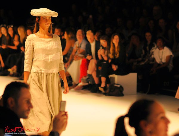 Fawn smock dress with subtle check motif, circle cushion hat; Matiny Ng's 580 fashion label at MBFWA Raffles International Showcase, Carriageworks Sydney. Photographed by Kent Johnson.
