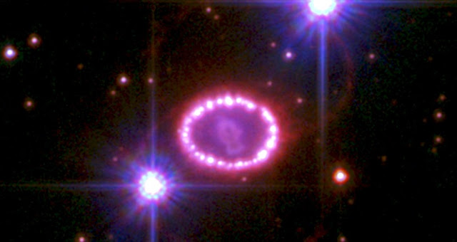 This Hubble Space Telescope image of the remnant of Supernova 1987A shows a bright inner ring glowing as it interacts with material from the supernova blast. The ring is approximately one light-year in diameter. It is not clear what is causing the two larger, fainter rings. The two bright objects are stars in the Large Magellanic Cloud. The image was taken in 2010. Image: NASA, ESA, R. Kirshner and P. Challis (Harvard-Smithsonian Center for Astrophysics)