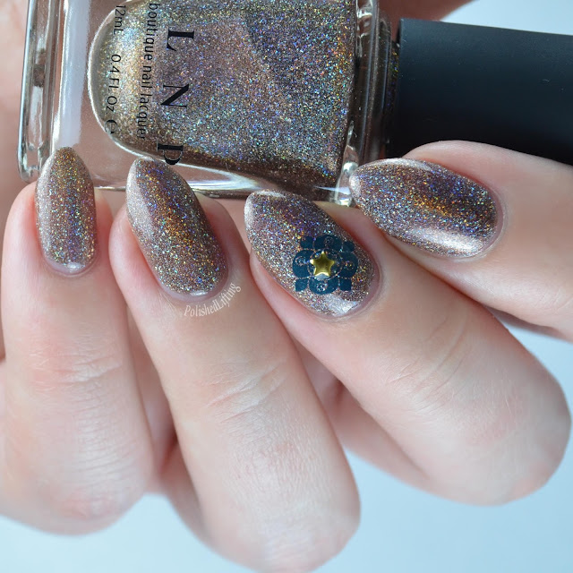 brown holographic nail polish with star and stamp