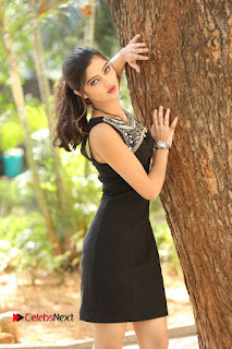 Actress Poojitha Pallavi Naidu Stills in Black Short Dress at Inkenti Nuvve Cheppu Movie Platinum Disc Function  0149.JPG