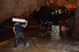 Boys receiving food, medical care inside cave